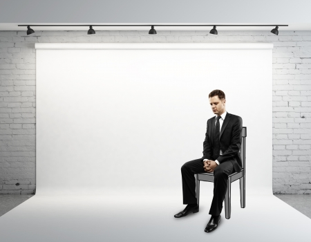 designer chair: businessman sitting on drawing chair Stock Photo