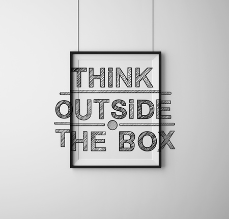 outside the box: frames with  think outside the box on wall