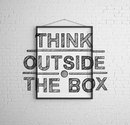 outside the box: frames with  think outside the box on brick wall