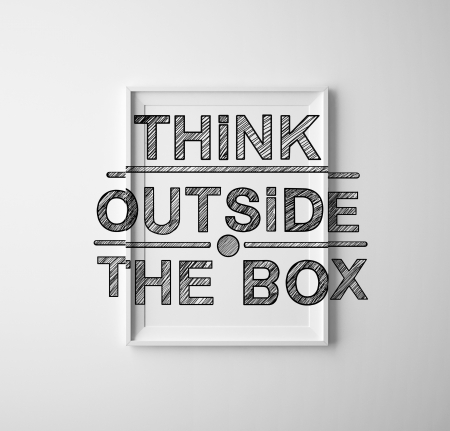 frames with  think outside the box on white wall photo