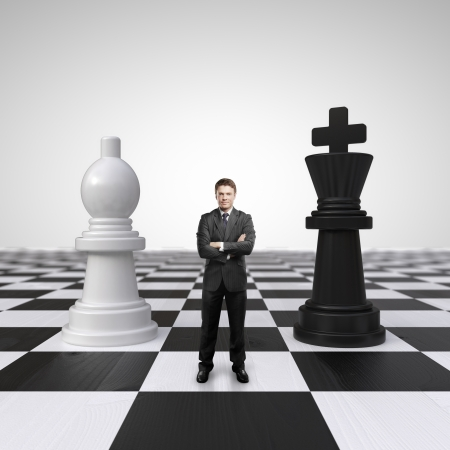 chessboard: young businessman standing on chessboard with chess Stock Photo