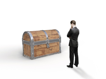 businessman looking at old antique chest on white background photo