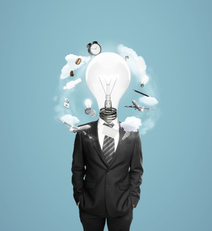 businessman with head bulb and fluing around things  isolated on blue photo