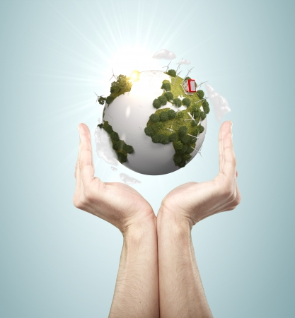 hands holding earth on blue background Stock Photo - 21689870