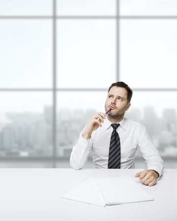 businessman thinking sitting at table photo