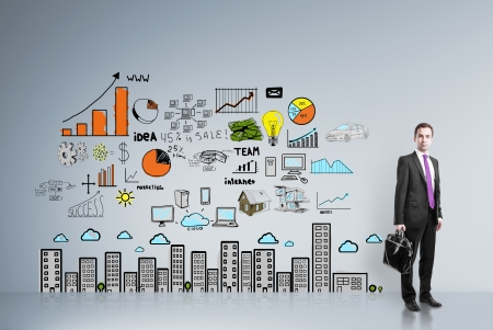 businessman standing in room with drawing  business strategy on wall Stock Photo - 21501013