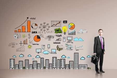 businessman standing in office with drawing  business concept on wall Stock Photo - 21501014