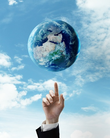 singn: hand pushing at earth on a sky background