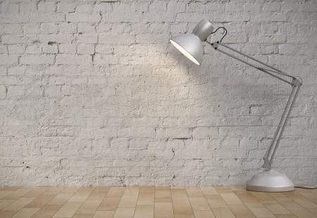 white desk lamp in brick interior Фото со стока