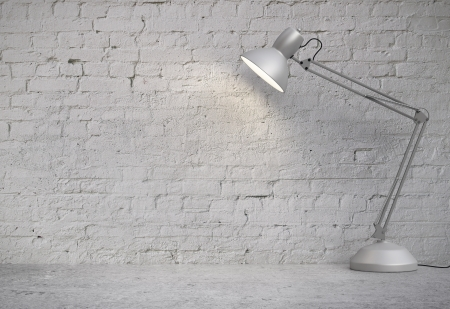 desk lamp in white  brick interior Stock Photo - 21689899