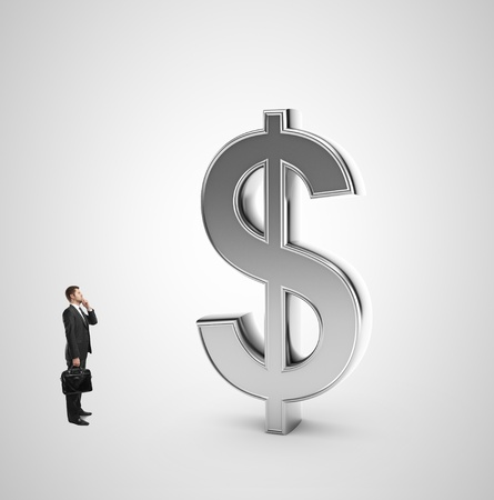 dollar symbol: businessman with briefcase looking at dollar symbol on a white background