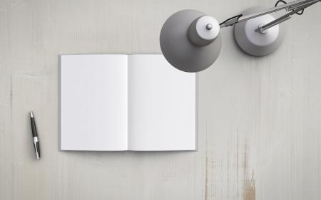 pad pen: libro abierto sobre la mesa con la l�mpara blanca