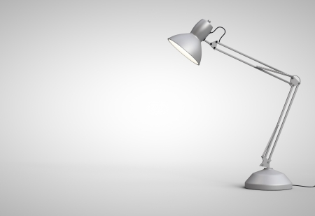 Vintage white desk lamp isolated on gray photo
