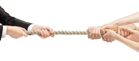 business rival: Various hands during tug war Stock Photo