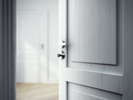opened: opened door in gray room Stock Photo