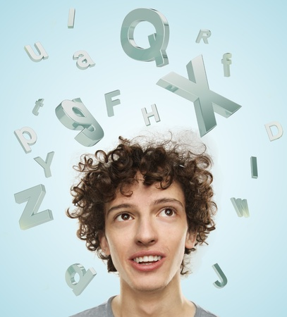 young man looking at flying letters photo