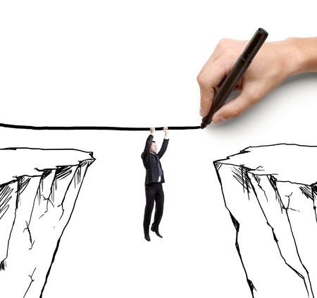 ascend: hand drawing businessman hanging by a rope and rock Stock Photo