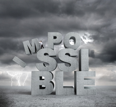 infeasible: businessman pulling letters impossible concept on bad weather background