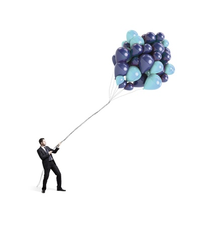 businessman trying to hold the rope with balloons photo