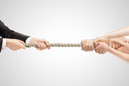tug of war: Various hands during tug war on white backgrounds Stock Photo