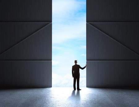 open gate: man open doors to hangar