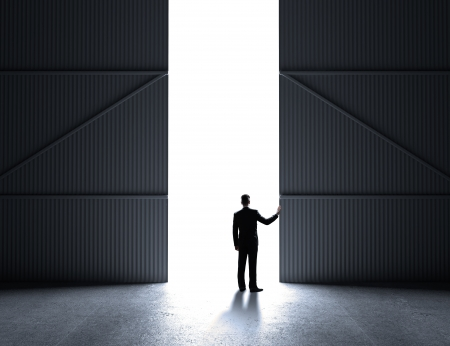 open gate: businessman open doors to hangar Stock Photo