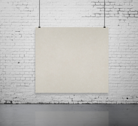 brick room with blank poster on wall photo