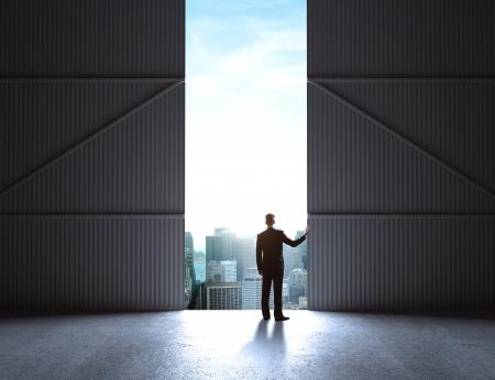 concrete room: businessman open doors to hangar Stock Photo