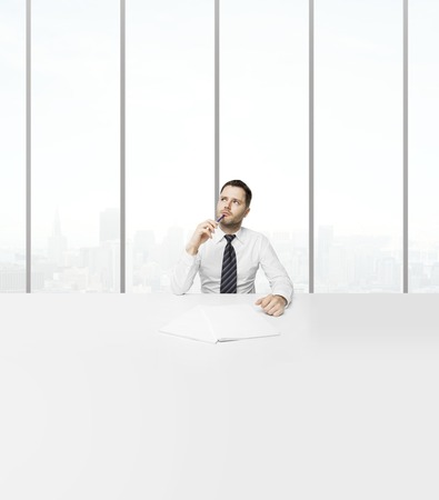 man sitting in office and dreaming photo