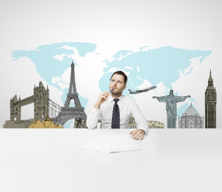 businessman sitting in office and dreaming at travel photo