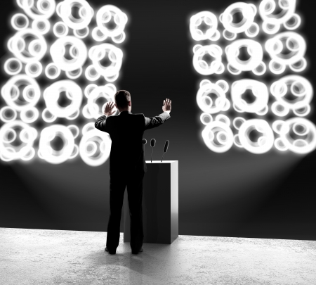 outbreaks: businessman standing on stage and closes on outbreaks Stock Photo