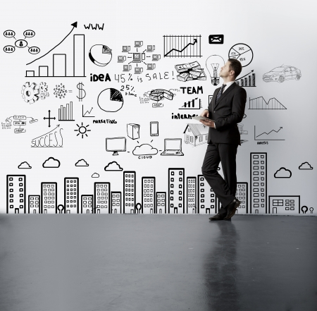 man lookig at drawing business concept on wall photo
