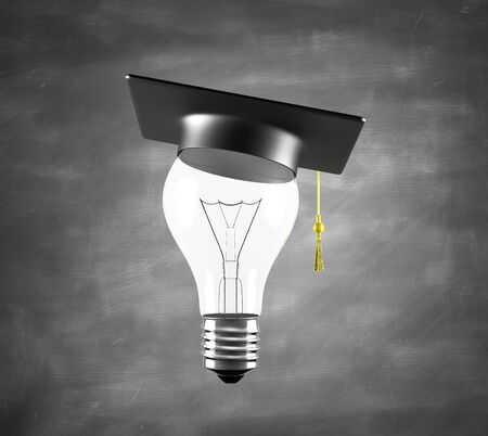 lamp with graduation hat and drawing business concept photo