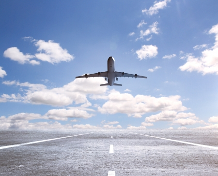airplane on runway and looking at airplane in blue sky Stock Photo