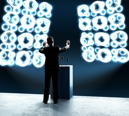 rostrum: businessman standing on rostrum and closes on outbreaks