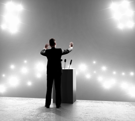 rostrum: businessman standing on podium and closes on outbreaks