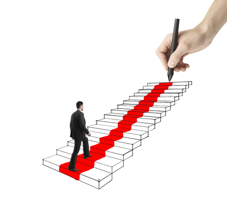 difficult journey: young businessman walking on drawing ladder with red carpet Stock Photo