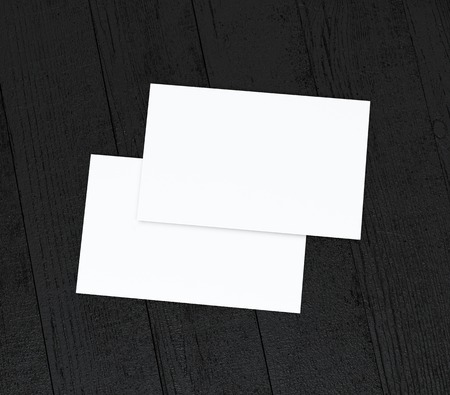 visiting card design: two business cards stack up on black   wooden table Stock Photo