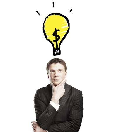 pensive businessman with a drawing lamps over his head photo