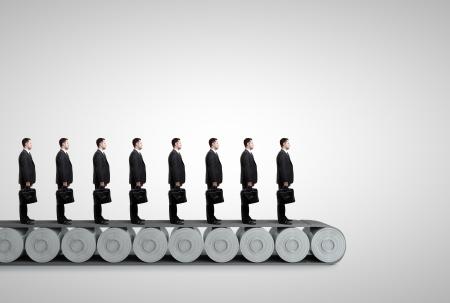 conveyor: group of people standing on conveyor