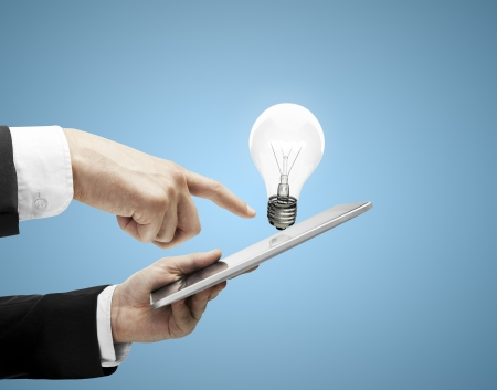 man with digital tablet in hands and lamp Stock Photo - 22392972