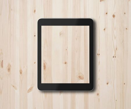 touch pad: digital touch pad on a wooden background