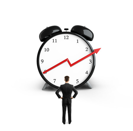 businessman looking at clock with up red  arrow photo