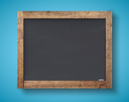 blank blackboard on a blue wall photo