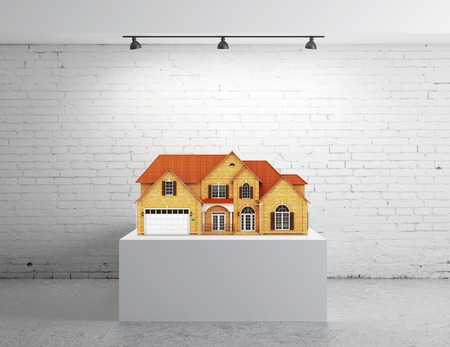white brick room and podium with home photo