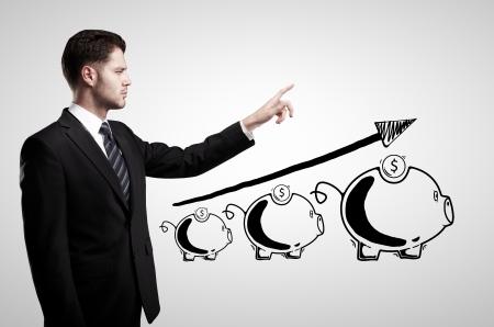 zakenman en spaarpot op een witte achtergrond