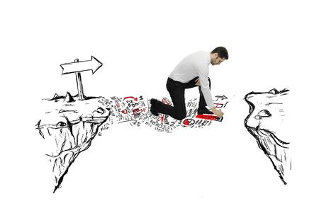 businessman drawing abstract bridge the gap