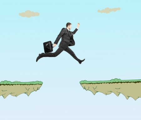 young man with briefcase jumping at drawing rock photo