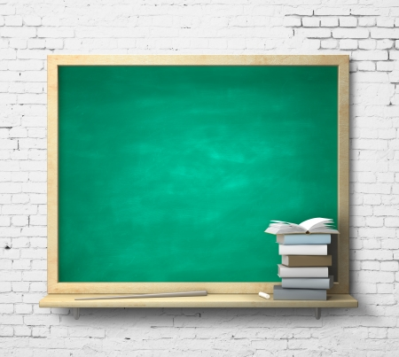 green blackboard and book on a brick wall photo