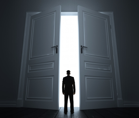 leaving: young man in white room with doors open